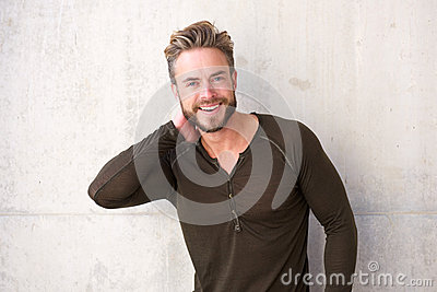 Trendy guy with beard smiling