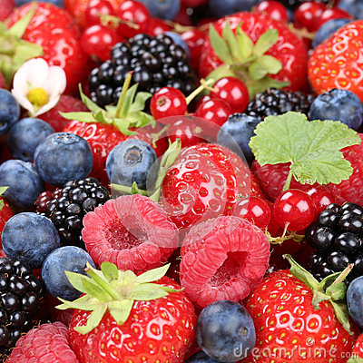 Berry fruits in summer with strawberries, blueberries and raspbe