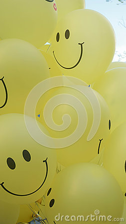 Smiley face blur on the yellow balloons 4