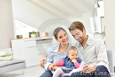 Portrait of happy family of three at home