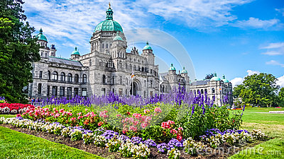 Historic parliament building in Victoria with colorful flowers, Vancouver Island, British Columbia, Canada