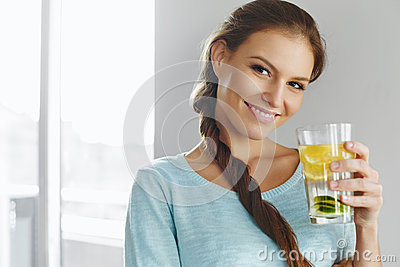 stock image of healthy lifestyle and food. woman drinking fruit water. detox. h