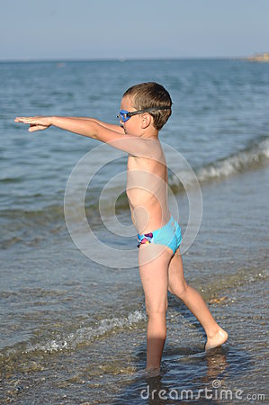 A boy prepares to dive