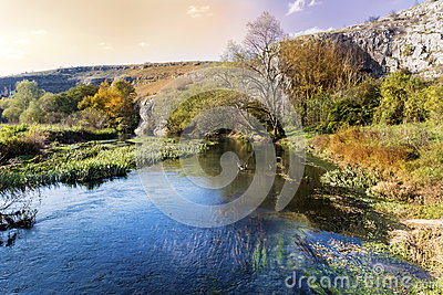 Beautiful picturesque autumn landscape of river in the mountain
