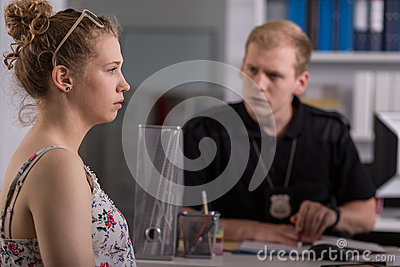 Woman at police station