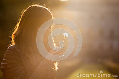 Delicate and fragile girl, sweet hope woman and nature. Romantic sunset.