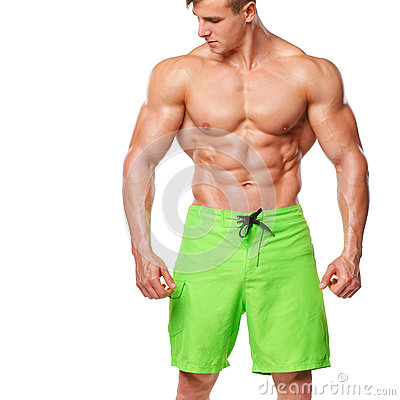 athletic man showing muscular body and sixpack abs, isolated over white background. Strong male nacked torso