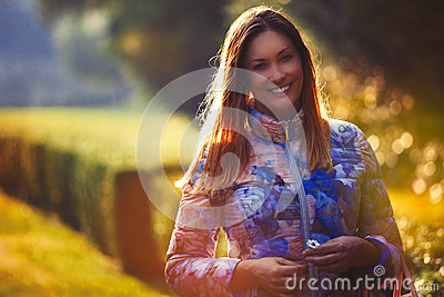 stock image of young joyful woman in love, outdoor backlight. emotions and happiness