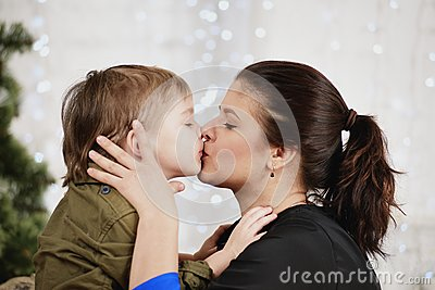 Christmas love and happy family little boy kissing mother little boy kissing mother thecheapjerseys Images