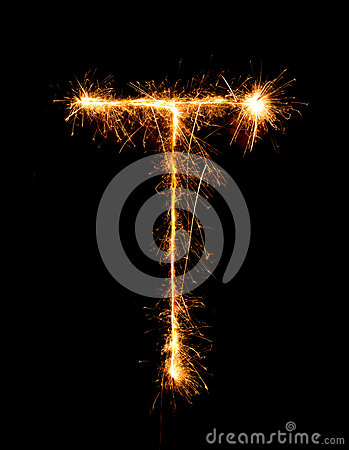 Sparkler firework light alphabet T (Capital Letters) at night