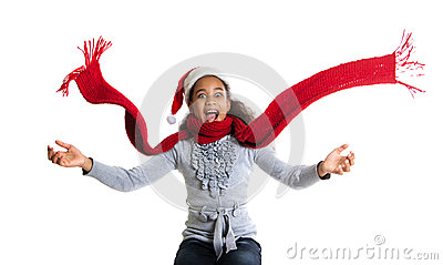 Cheerful  girl in a red scarf and hat of Santa Claus. Winter portrait of joyful adolescent girls