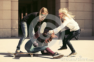 Group of teen girls playing with skateboard