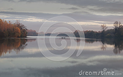 Tisa river,fisher boat in autumn november afternoon