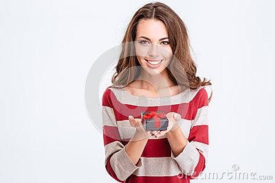 Smiling charming woman holding jewelry gift box