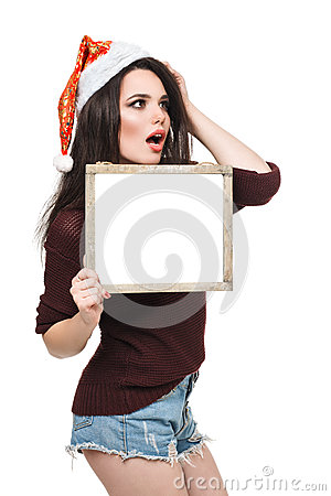Woman in Santa hat holding big white card