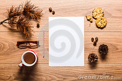 Magical christmas theme background, pine cones, coffee, cookies and an empty letter to santa