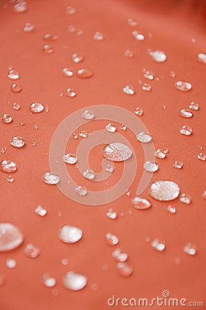 Waterproof coating textile, background with water drops.