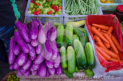 Plenty of fruits and vegetables,eggplants,cucumbers, coconuts,beans, carrots, chili peppers