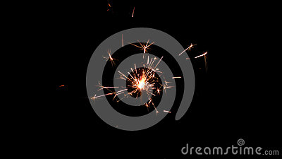 Centrally positioned firework sparkler burning isolated