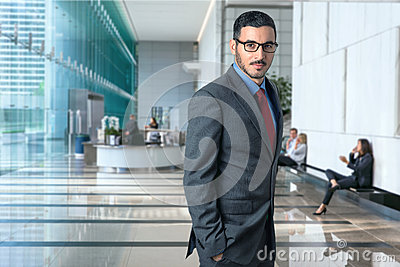 Lifestyle portrait of modern executive professional businessman attorney lawyer in business office elegant style confident