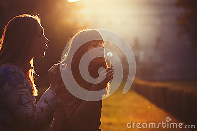 stock image of women freedom and hope. nature and harmony. romantic sunset.
