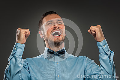 Portrait excited, happy man, arms up fists pumped celebrating su