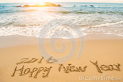 Write happy new year 2016 on beach