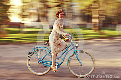 Cheerful girl on a bicycle