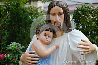 Statue of Christ and Child In Hug.