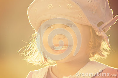 Portrait shot of cute three year old smiling girl
