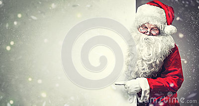 Santa Claus pointing on blank advertisement banner background with copy space