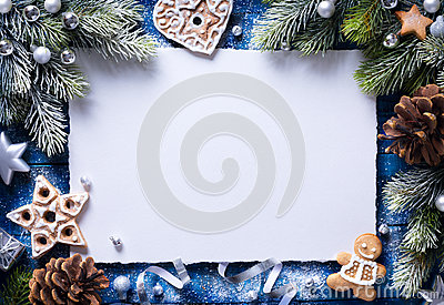 Art Christmas background with gingerbread cookies and festive decora