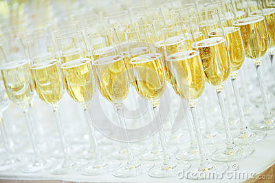 Glasses with sparkling wine in row