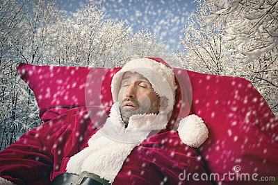 Santa Claus sleeping in the snow