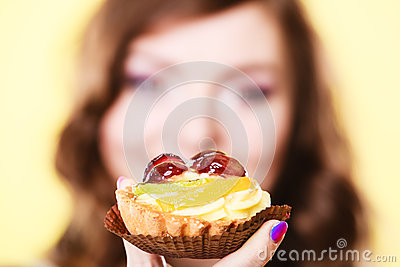 Cupcake cake in woman hand. Sweet food.