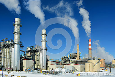 Coal Fossil Fuel Power Plant Smokestacks Emit Carbon Dioxide Pollution On A Cold Snowy Day