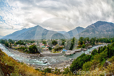 Village in Kullu Valley, Beas river foreground