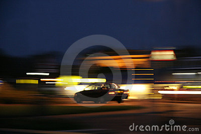 Blurred lights and car