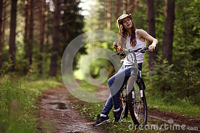 Girl on bike at forest