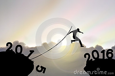 Man jumping over precipice , far in distance with pole vault on