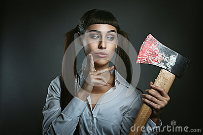 Dangerous woman with axe full of blood