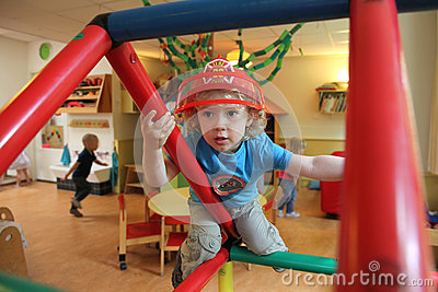 Young boy playing in a creche (nursery)