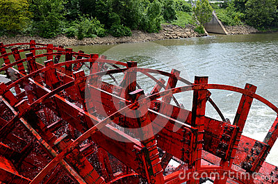 Paddle boat wheel spinning in the water