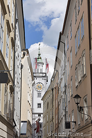 Clock tower of Old Town Hall with flags in Salzburg, Austria, Europe