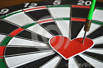 Heart and arrow on dart board