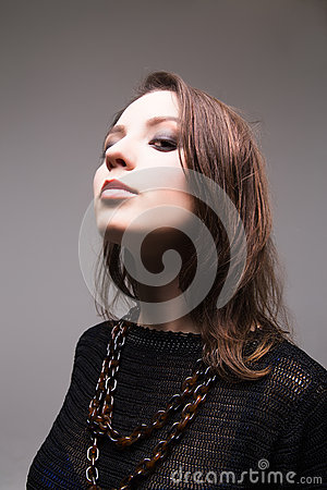 Stylized portrait of a brunette young adult woman