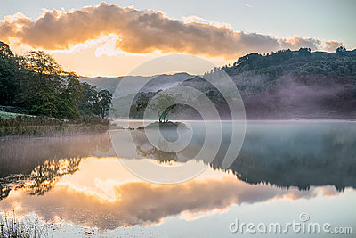 Mirrored sunrise on Rydal Water, in the Lake District