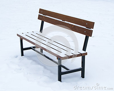 Wooden bench covered with snow - winter time Christmas