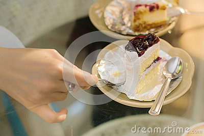 Woman hand put pudding on the cake crust