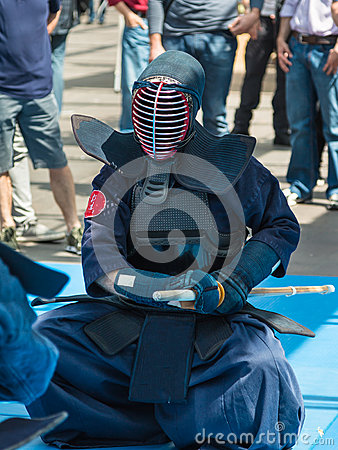 Kendo Warrior on His Knees fighting in Traditional Clothes and B